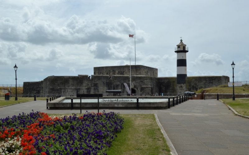 photo of southsea castle with iconic black and white lighthouse.
