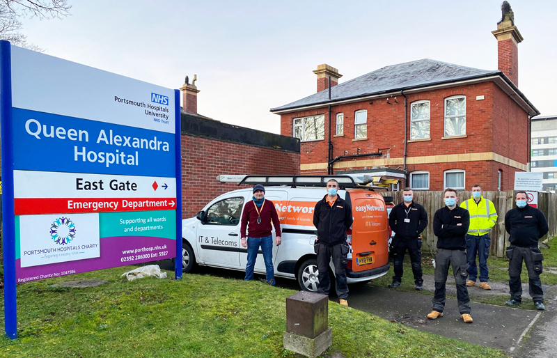 Richard Gwilliam (L) and the easyNetworks cabling installation team on site at Queen Alexandra Hospital, Portsmouth 15/1/2021